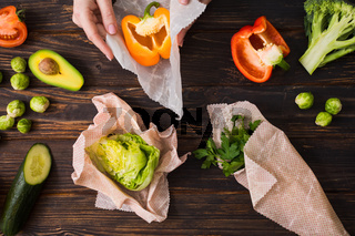 Plastic free kitchen concept. Beeswax wraps with food on them