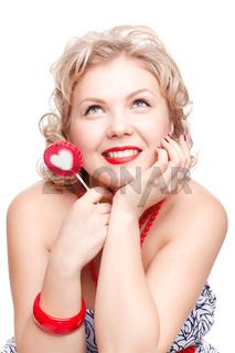 blonde woman with lollipop
