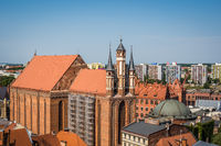 Church of the NMP surrounded by buildings in Torun