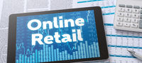 A tablet with financial documents - Online Retail