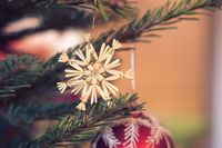 Traditional Christmas tree with Christmas decoration, close up of Christmas bauble. Postcard.