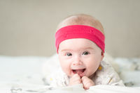 Portrait of a beautiful baby on bright background