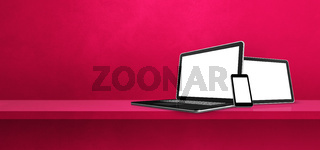 Laptop, mobile phone and digital tablet pc on pink wall shelf. Banner background