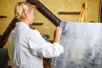 Woman having fun painting in art class