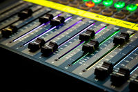 Sliders and buttons on Audio Mixing Desk at live event