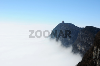 Landscape of moutains tops with clouds and blue sky