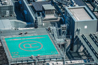 The roof of the machine room and the heliport of the high-rise building