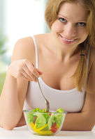 beautiful woman with vegetable vegetarian salad