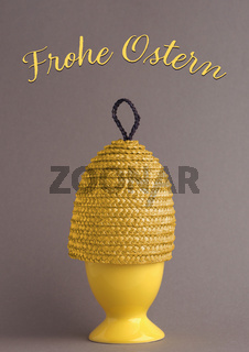 German happy Easter with a yellow Easter egg