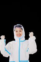 Women doctors taking off masks celebrate