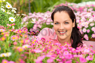 Portrait beautiful woman with pink daisy flowers