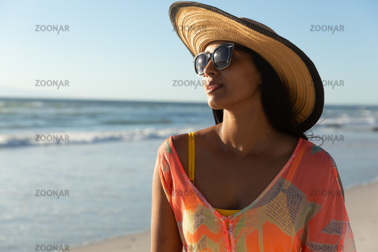Portrait of mixed race woman on beach holiday