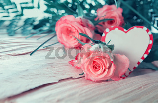 Mother's Day card with pink roses and heart.