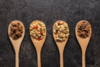 Various breakfast cereals. Morning granola in wooden scoop.