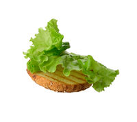 green lettuce leaf lies on a half of a round bun, food