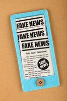 Felt craft smartphone with FAKE NEWS newspapers