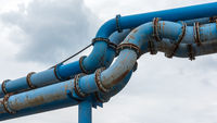 Composite of blue water pipes on a construction site