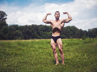 Young Muscular Shirtless Hunk Man Outdoor in Nature