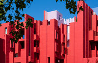 Facade of the postmodern apartment building 'La Muralla Roja', the red wall, by architect Ricardo Bofill in Calpe, Spain