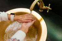 Close up photo of woman washes her hands with soap and water.