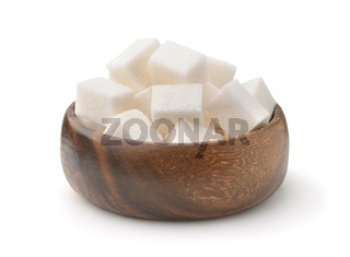 Wooden bowl of white refined sugar cubes