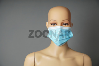 shop window mannequin or display dummy head wearing medical face mask