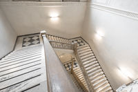 Luxury staircase made of marble in an antique Italian palace