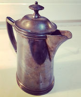 steel jug with a handle and lid.