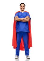 smiling doctor or male nurse in superhero cape