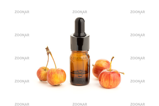 Apple essential oil isolated on white background. Apple oil