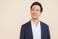 Asian businessman smiling and relaxing with eyes closed