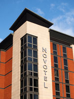 logo and banner sign on the corner of a novotel inn hotel on whitehall road in leeds