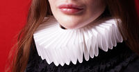 white ruff or ruffled collar worn by unrecognizable lady
