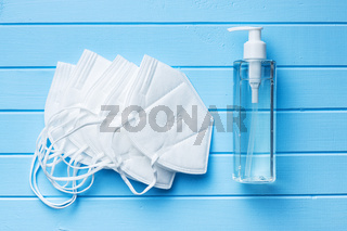 Coronavirus prevention hand sanitizer and kn95 respirator mask. Hand disinfectant gel in pump bottle.