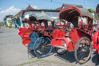 Trishaws in the street of Surakarta, Indonesia