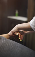Woman masseur giving massage to client