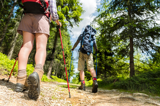 Hikers walking with trekking poles