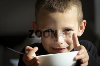 Little boy eat soup