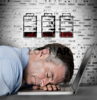 Businessman sleeping on his laptop with no battery symbols
