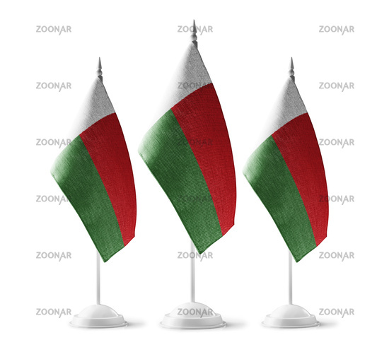 Small national flags of the Madagascar on a white background