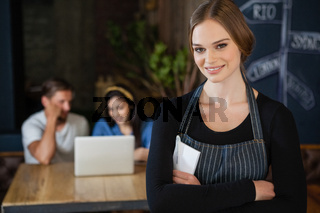 Portrait of smiling owner standing against customer