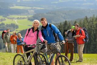 Sporty cyclist couple hikers springtime weekend