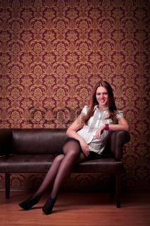 smiling girl sitting on sofa
