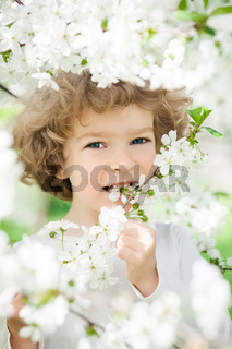 Happy child with spring flower