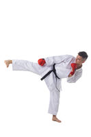 Man training taekwondo on white