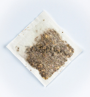 herbal tea bag laying on table