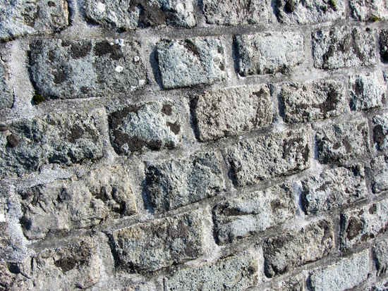 Steinmauer in grau