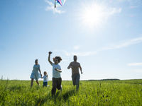 Running with kite on summer vacation