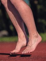 Barefoot jumping woman warm up muscles and stretching body