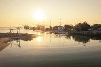 Nice panoramic view of fishing huts at sunrise near Ravenna